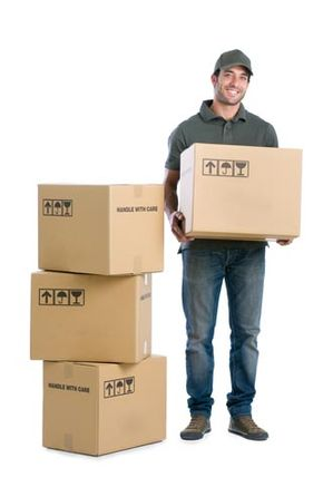 Mover holding a box next to a pile of boxes